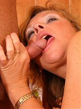 This horny old slut loves a hard throbbing cock